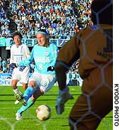 Jubilo iwata's gral scores on a penalty kick in the 60th min ute during a J. League first-division match against Gamba Osaka on Saturday at Iwata Stadium. Jubilo won 2-1.