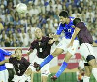Sota Hirayama of Japan scores in the 59th minute of Friday's match against Venezuela in an Olympic tuneup match at Tokyo's National Stadium. Japan won 4-0.