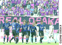Gamba Osaka's Masashi Oguro (16) is congratulated by his teammates after scoring a goal in the first half against crosstown rival Cerezo at Expo Stadium. Oguro netted a hat trick in Gamba's 7-1 rout.