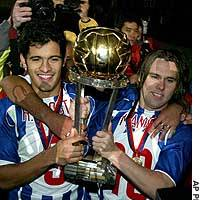Porto's Ricardo Costa (left) and Quaresma hold up the Toyota Cup after the Portuguese team beat Once Caldas of Colombia in Yokohama.