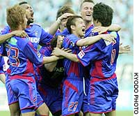 Ryoichi Kurisawa (No. 27) of FC Tokyo celebrates with his teammates after scoring in the 85th minute in a 1-0 win over Jubilo Iwata on Sunday at Ajinomoto Stadium.