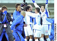 Gamba Osaka players and staff celebrate after clinching their first-ever J. League title with a 4-2 victory over Kawasaki Frontale at Todoroki Stadium on the final day of the season.
