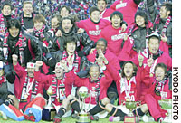 Urawa Reds players celebrate after winning the 85th Emperor's Cup at Tokyo's National Stadium on Sunday, beating Shimizu S-Pulse 2-1 in the final.