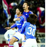 Yokohama Defender Naoki Matsuda is congratulated by teammates after scoring in the 40th minute Saturday against Gamba Osaka in Yokohama.