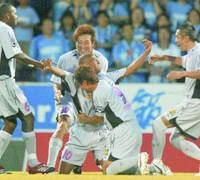 Cerezo Osaka midfielder Pingo celebrates with his teammates after scoring their first goal against Jubilo at Yamaha Stadium on Saturday. Iwata won 3-1. | KYODO PHOTO