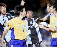 Kawasaki Frontale defender Hideki Sahara (far left) clashes with JEF United Chiba players minutes before the whistle during a Nabisco Cup semifinal first-leg tie on Sunday in Kawasaki. | KYODO PHOTO