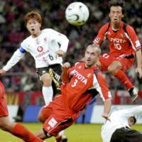 Nagoya Grampus Eight's Frode Johnsen (3) scores the match's only goal in the 79th minute against Urawa Reds in their J. League match on Saturday at Toyota Stadium. | KYODO PHOTO