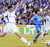 Gamba Osaka forward Magno Alves scores the winning goal in the 83rd minute during the J. League first-division match against Ventforet Kofu on Saturday at Kose Sports Park Stadium. Gamba won 2-1. | KYODO PHOTO