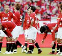 Urawa Reds players look disappointed after their 25-match unbeaten streak at home was ended Saturday with a 2-1 loss to Kawasaki Frontale at Saitama Stadium. | KYODO PHOTO