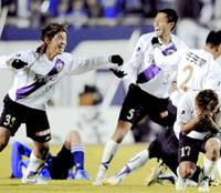 Kyoto Sanga players celebrate their promotion to the top division after Saturday's game in Hiroshima.   KYODO PHOTO