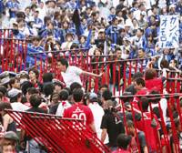 Wild match: Unruly Reds fans rip through fencing at Saitama Stadium after Urawa's controversy-marred 3-2 loss to visiting Gamba Osaka on Saturday. What's more, Reds goalkeeper Ryota Tsuzuki was involved in an on-field scuffle with Osaka players after the match.   KYODO PHOTO