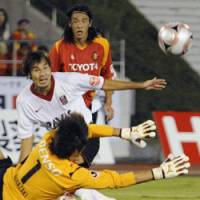 Honors even: Urawa Reds striker Naohiro Takahara shoots during his side's 1-1 draw with Nagoya Grampus at Mizuho Stadium, Nagoya, on Sunday. Grampus leads the J. League standings by one point. | KYODO PHOTO