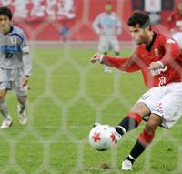 Exorcising the demons: Urawa's Robson Ponte converts a penalty for the only goal of the game against Ehime FC in Emperor's Cup fourth-round action on Monday. | KYODO PHOTO