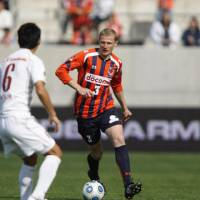 Well traveled: Omiya Ardija's Mato Neretljak, who has played professionally in several countries, is one of the top defenders in the J. League. | © 1998 N.O. ARDIJA
