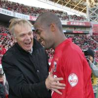 Satisfaction: Urawa Reds manager Volker Finke congratulates Edmilson after the Brazilian scored a hat trick in a 3-2 victory over Jubilo Iwata on Saturday.   KYODO PHOTO