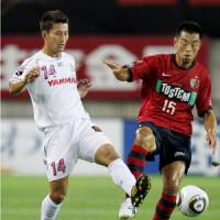 In the pink: Fit-again striker Akihiro Ienaga (left) has helped Cerezo Osaka into second place in the J. League table. | KYODO PHOTO