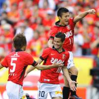 Perfect 10: Urawa's Marcio Richardes (10) celebrates with teammates after opening the scoring against Nagoya Grampus in Reds' 3-0 win on Sunday. | KYODO