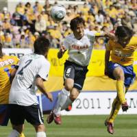 Not over yet: Vegalta's Makoto Kakuda (right) heads in a goal against Jubilo on Saturday. The game finished 3-3. | KYODO PHOTO