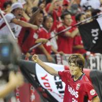 Right on time: Reds' Genki Haraguchi gestures after his late equalizer helped Urawa avoid a loss against Gamba on Saturday in Saitama. | KYODO PHOTO