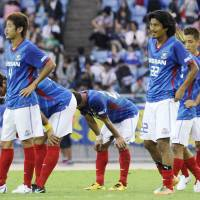 Agony of defeat: Yokohama F. Marinos players react after their 3-1 loss to Vegalta Sendai on Saturday at Nissan Stadium. | KYODO PHOTO