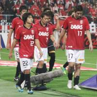 Disappointment: Urawa Reds players walk off the pitch after a 1-0 loss to Omiya Ardija on Saturday. | KYODO PHOTO