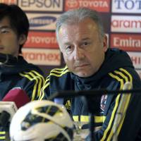 Almost there: Japan manager Alberto Zaccheroni listens to a question at a news conference in Amman on Monday ahead of his team's World Cup qualifier against Jordan. | AFP-JIJI