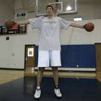 Giant player: New Hamamatsu Higashimikawa Phoenix center Sun Ming Ming, who will make his bj-league debut in the fall, is 236 cm tall. The tallest players in NBA history, Manute Bol and Gheorghe Muresan, are 231 cm.   AP PHOTO