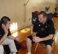 Meeting time: Ryukyu Golden Kings coach Dai Oketani (left) and assistant coach Keith Richardson talk about the team's next opponent, the Takamatsu Five Arrows, earlier this week in Okinawa. Ryukyu (6-0) is the bj-league's lone unbeaten team.   RYUKYU GOLDEN KINGS
