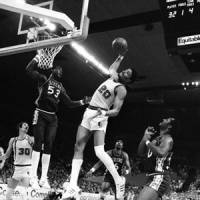 The Enforcer: Maurice Lucas, shown grabbing a rebound against the 76ers on May 29, 1977, as the Trail Blazers were on their way to an NBA championship, died Sunday in Portland. | AP PHOTO