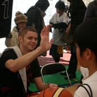 Giving back: Grayson Boucher shares a moment with a young fan during an autograph session in Toyosu. | KAZ NAGATSUKA