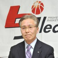 Challenging times: Toshimitsu Kawachi, the bj-league's commissioner, listens to a question during a news conference on Thursday in Tokyo's Minato Ward. | YOSHIAKI MIURA PHOTO