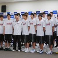 All for one: Members of the Japan men's national basketball team, including coach Thomas Wisman (in jacket), have started preparations for this summer's regional and continental tournaments. | KYODO