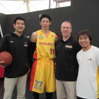 Providing inspiration: (Left to right) Sendai 89ers general manager Takeo Mabashi, forward Yoshihiro Tachibana, head coach Bob Pierce, captain Takehiko Shimura and the rest of the team have been embraced by the public as the 2011-12 bj-league season gives an outlet for the grief-stricken Tohoku region.   ED ODEVEN PHOTO