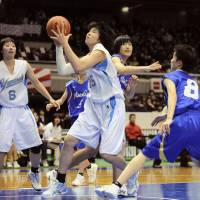 Twice as nice: Sapporo Yamanote standout Moeko Nagaoka takes a shot during the final of the Winter Cup on Wednesday in Tokyo. | KYODO