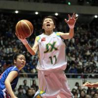Flower power: Ai Honda of the JX Sunflowers goes up for a shot during the All-Japan Championship final on Sunday. | KYODO