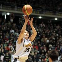 Up and over: Toyota's Taishi Ito takes a shot during the All-Japan Championship final on Monday. | KYODO
