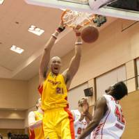 Show of force: Sendai 89ers center Rashaad Singleton completes a slam dunk against the visiting Hamamatsu Higashimikawa Phoenix on Saturday. The 89ers defeated the Phoenix 66-64. | DOMINIKA FITZGERALD