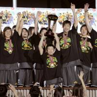 Celebration time: Toyota Motors Alvark players relish the spotlight after their JBL championship-clinching victory over the Aisin Sea Horse on Sunday at Yoyogi National Gymnasium No. 2. Toyota beat Aisin 83-64 in Game 4. | KYODO