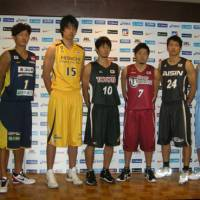 Hoop hopes: Players representing each of the JBL's eight teams prepare for this weekend's start of the new season at a Tokyo news conference on Monday. | KAZ NAGATSUKA