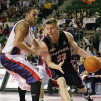 Victim of circumstances: Oita HeatDevils guard Matt Lottich (right), seen playing for the Osaka Evessa in 2008, is one of four players whose contracts have been voided by the cash-strapped franchise. | YOSHIAKI MIURA