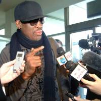 More famous than ever: Former NBA star Dennis Rodman is interviewed by journalists before leaving Pyongyang Airport last week. | AFP-JIJI