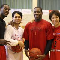 Team work: Toyama Grouses players (from left) Jeremy Jacob, Masashi Joho, Ira Brown and Mitsuhiro Kamezaki have helped lead the franchise to a 25-13 start this season. The Grouses have the weekend off. | MAYU NAGAO