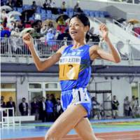 Victory celebration: Yuriko Kobayashi, seen winning the women's 5,000-meter race at the Japan Track and Field National Championships on June 29 at Kawasaki's Todoroki Stadium, will make her Olympic debut next month in Beijing. | KYODO PHOTO