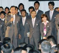Eager to speak: Japan baseball manager Senichi Hoshino (with mic) addresses the audience during Japan's Olympic sendoff ceremony at the Prince Park Tower hotel in Tokyo on Monday. More than half of Japan's 2008 Olympians attended the event. | KYODO PHOTO