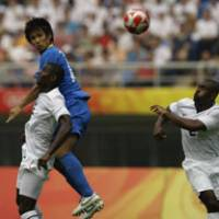 Head first: Japan's Hiroyuki Taniguchi challenges for the ball with Maurice Edu of the U.S. while Marvell Wynne watches on during the two sides' Olympic Group B match in Tianjin, China, on Thursday. The U.S. won 1-0. | AP PHOTO
