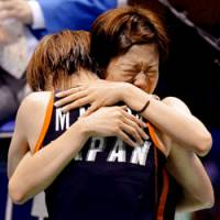 Miyuki Maeda and Satoko Suetsuna celebrate after beating defending Olympic champions Yang Wei and Zhang Jiewen of China in the women's badminton doubles competition on Monday. | KYODO PHOTO
