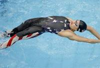 Back-to-back titles: Natalie Coughlin of the United States competes in the women's 100-meter backstroke final at the Water Cube on Tuesday in Beijing. Coughlin defended her Olympic title in a time of 58.96 seconds. | AP PHOTO