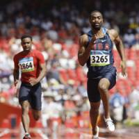 Great American hope: Tyson Gay of the U.S. runs his 100-meter heat on Friday at the Beijing Games. | AP PHOTO