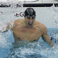 Seventh heaven: Michael Phelps exults after narrowly winning his seventh gold medal of the Beijing Games in the 100-meter butterfly on Saturday morning. Phelps won in a time of 50.58 seconds, beating Serbia's Milorad Cavic by just 0.01. | AP PHOTO