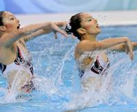 Saho Harada and Emiko Suzuki perform in the synchronized swimming duet free routine final at the Beijing Olympics on Wednesday. The Japanese pair took the bronze medal in the event. | KYODO PHOTO